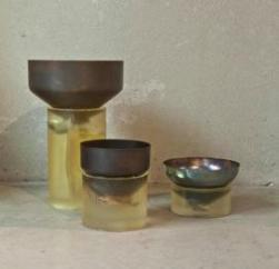 Series of vases in opaque resin and silver oxidized brass elements.
